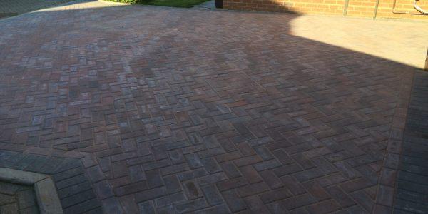 Herringbone pattern block paving.